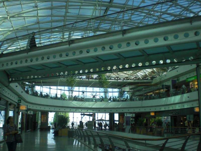 Interior of modern spacious and spacious shopping center with glass ceiling and walls stock images