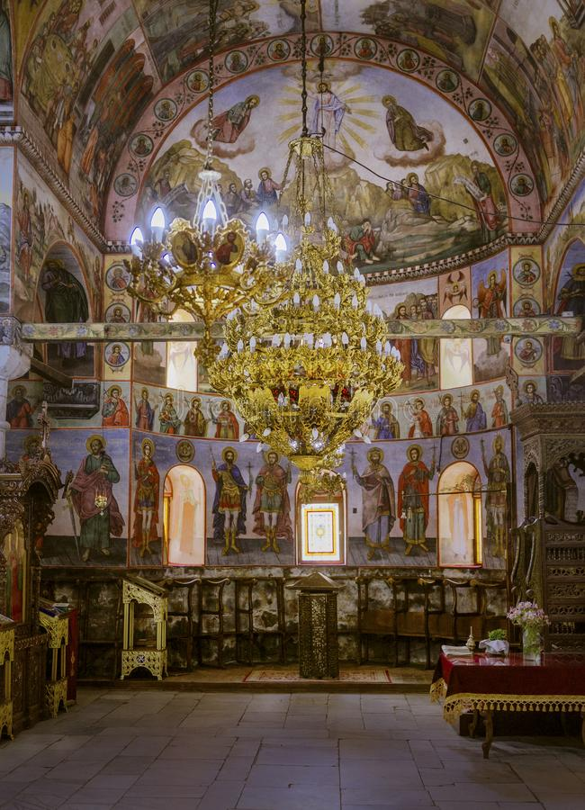 Bachkovo monastery Bulgaria. A chapel inside Bachkovo monastery Bulgaria with mural paintings and large chandelier stock photo