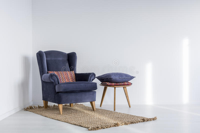 Interior with navy blue armchair royalty free stock image