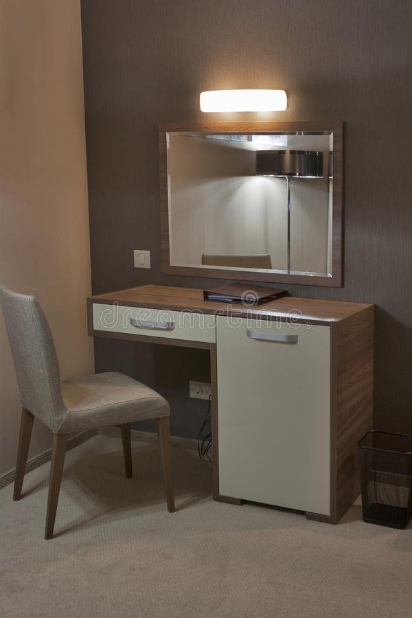 Interior with nightstand and mirror stock photography