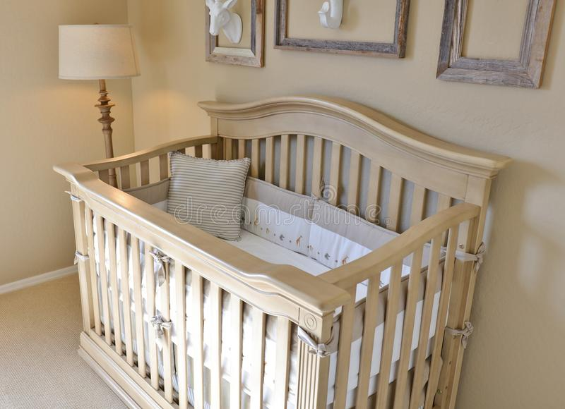Interior of a Nursery. With a baby crib royalty free stock photo