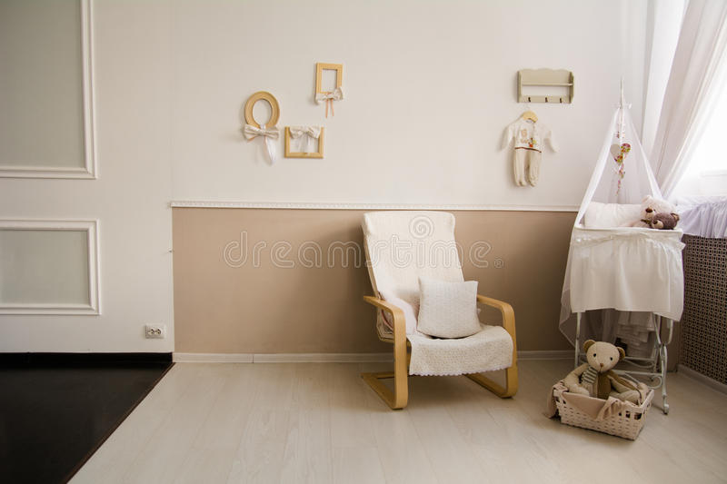 Interior of a nursery with a crib for a baby. stock photography