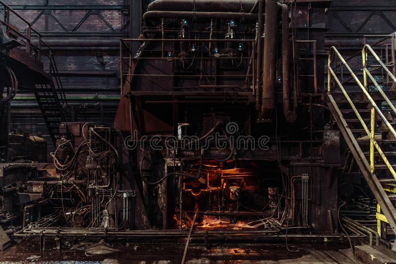 Interior of an old abandoned steel factory in western Europe. Fascinating warehouse industrial interior in eastern Europe royalty free stock images