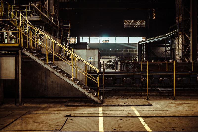 Interior of an old abandoned steel factory in western Europe. Fascinating warehouse industrial interior in eastern Europe stock image