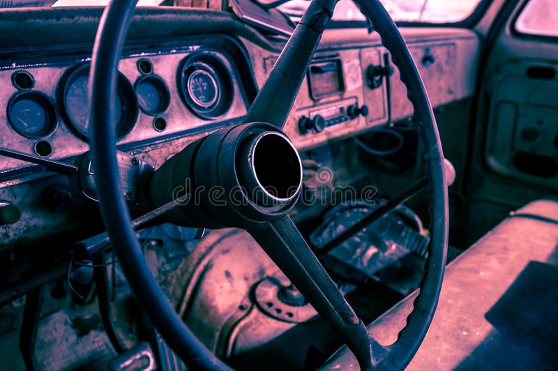 Interior of old abandoned truck, grunge background with rusty dashboard and driving wheel stock photos