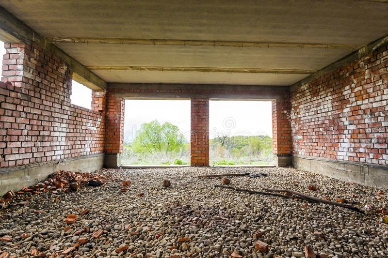 Interior of an old building under construction. Orange brick walls in a new house. stock photography