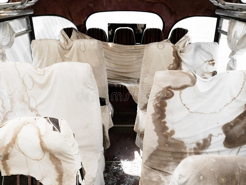 Interior of old bus with dirty sheets, scary atmosphere, shocking horror scene. Interior of old bus with dirty and bloody sheets, scary atmosphere, shocking royalty free stock photography