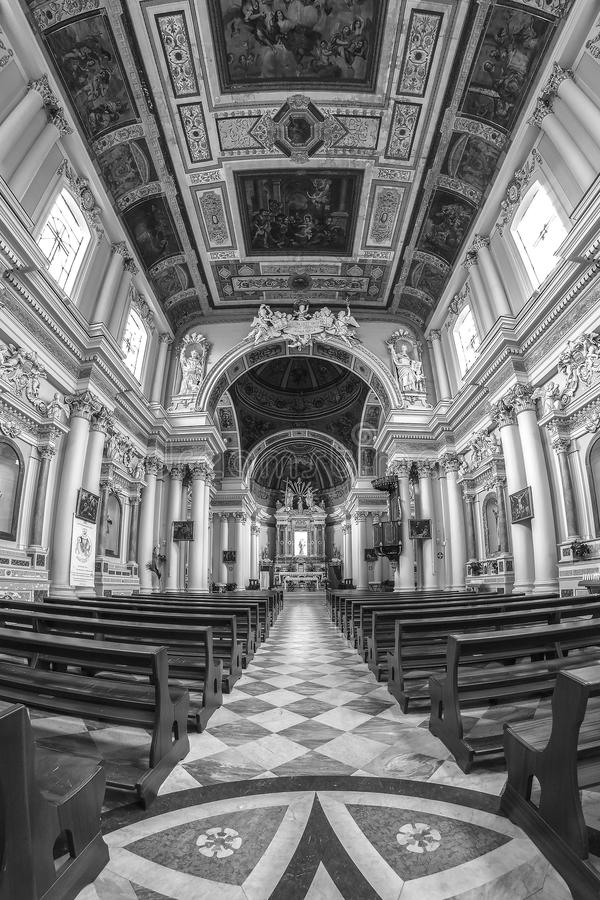 Interior of an old church with white columns and ornate ceiling stock photos