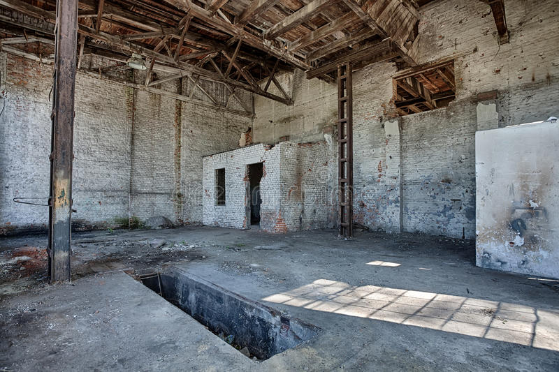 Interior of the old factory. Hall in an abandoned factory stock images