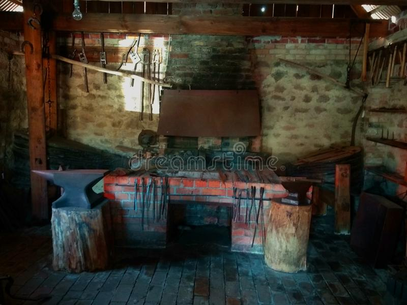 The interior of the old forge in the museum. royalty free stock images