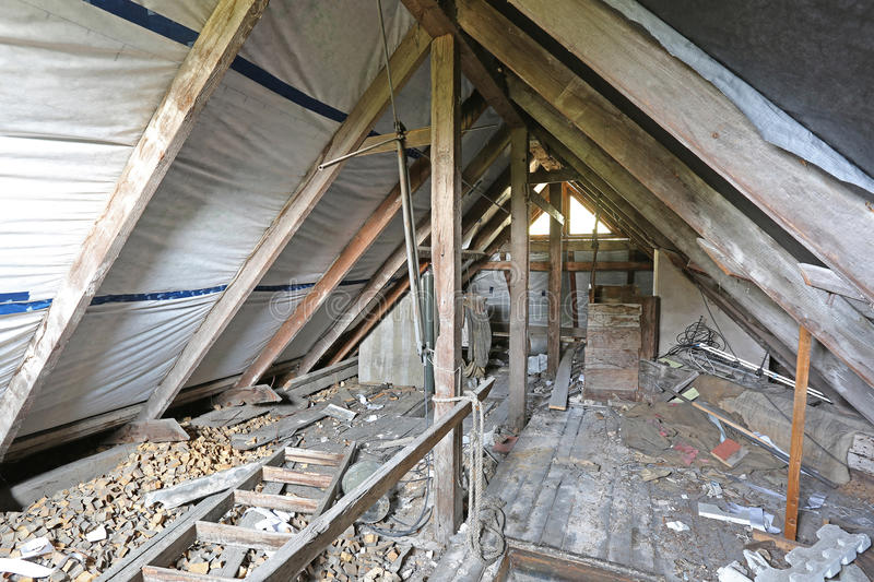 Interior of old messy attic royalty free stock photography