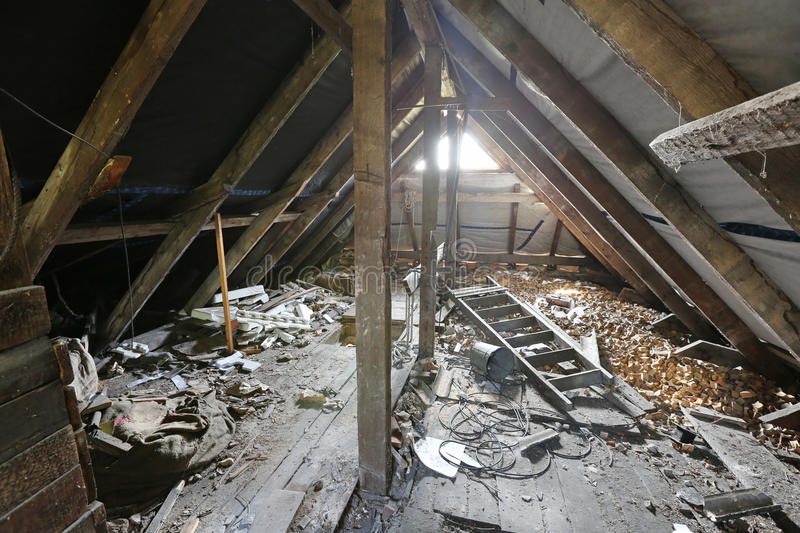 Interior of old messy attic royalty free stock image
