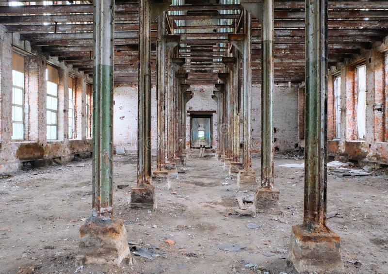 Interior of the old ruined factory. Floor royalty free stock image