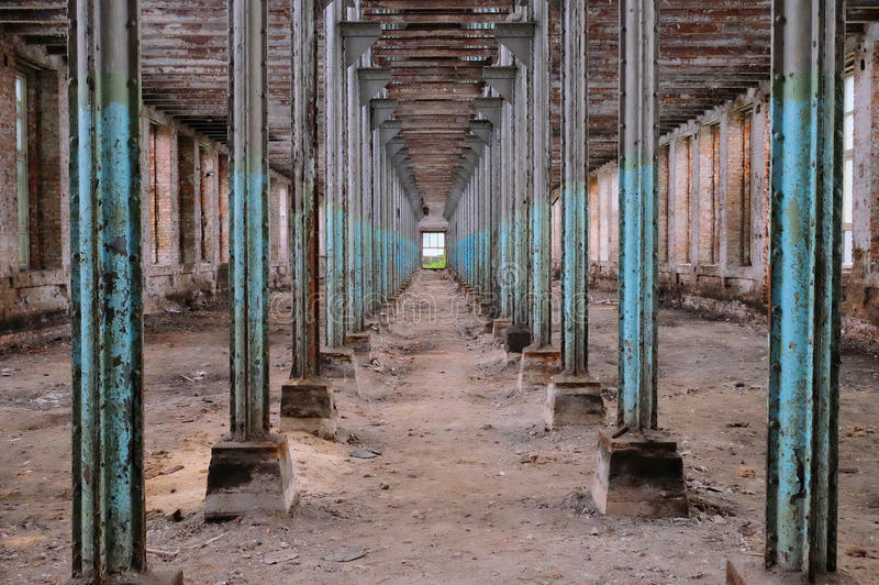 Interior of the old ruined factory. Floor stock images