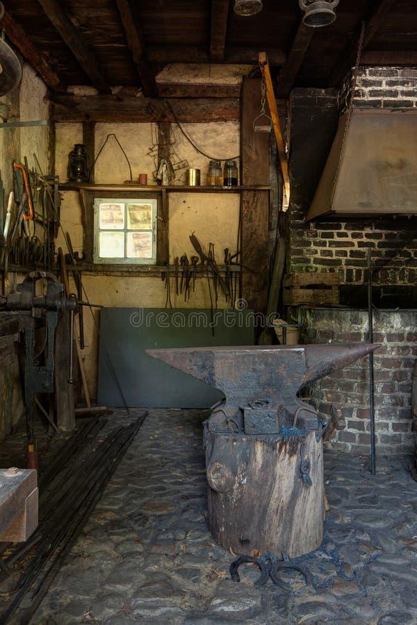 Blacksmith, forge, smithy, anvil, Bokrijk, Limburg, Limbourg, Belgium royalty free stock photos