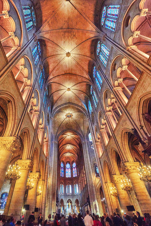 Interior of one of the oldest Cathedrals in Europe- Notre Dame de Paris. PARIS, FRANCE - JULY 04, 2016 : Interior of one of the oldest Cathedrals in Europe stock photos