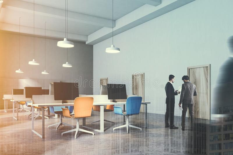 Interior of orange and blue chairs office toned. Orange and blue chairs open office interior with a conrete floor, rows of computer desks. Wooden doors, people royalty free illustration