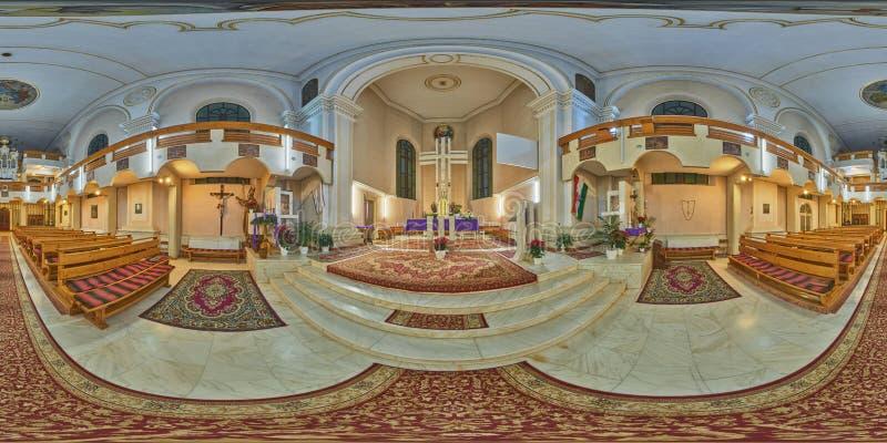 360 interior panorama of Holy Trinity Catholic Church in Sovata, Romania. Interior spherical panorama shot in Holy Trinity Catholic Church in Sovata, Romania royalty free stock photography