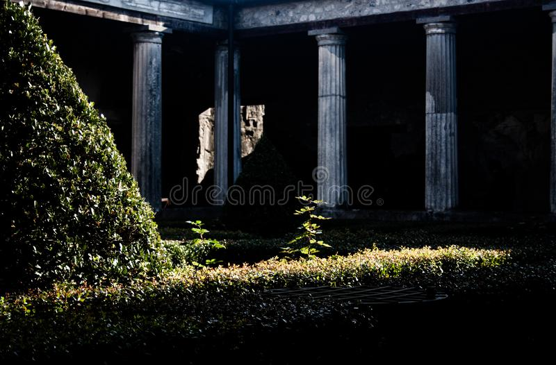 Interior patio of a house of Pompeii. Photograph of one of the preserved interior courtyards of the houses of the city of Pompeii, Naples stock photo