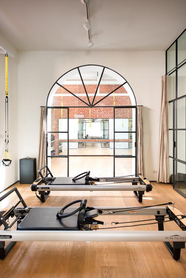 Interior of a Pilates gym with reformer beds royalty free stock image
