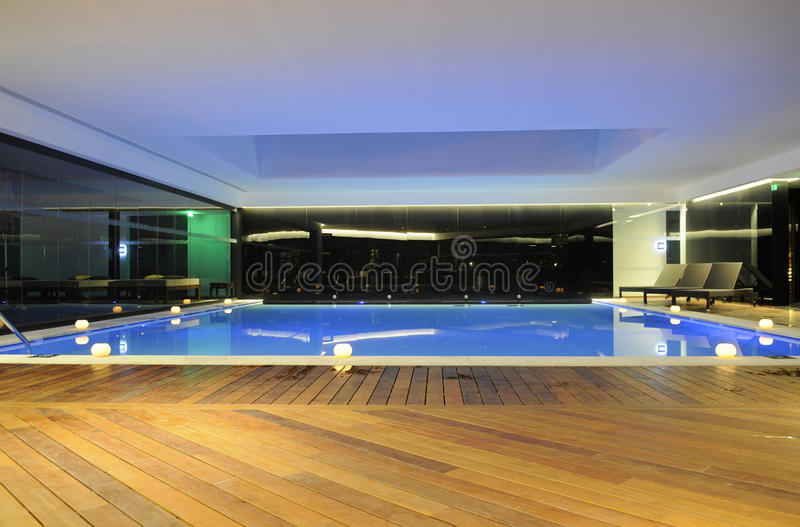 Interior Pool with Wooden Deck - Luxury Home_Hotel royalty free stock photography