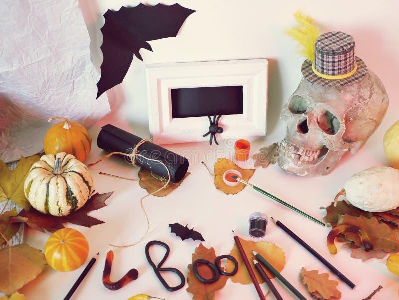 Interior preparation for Halloween. Decorative composition of a skull, pumpkins, mystical decor, art materials, leaves, interior preparation for Halloween, top stock image