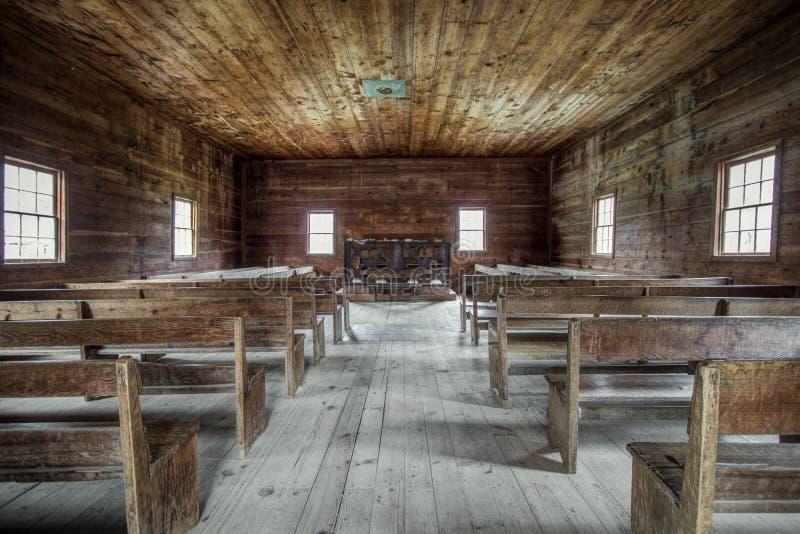 Interior primitivo da igreja do pioneiro de Rusitc fotografia de stock