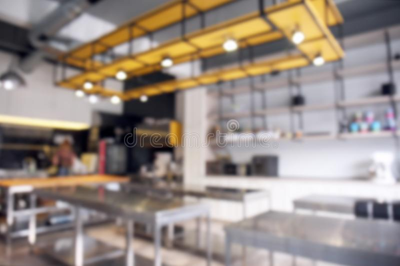 Interior of professional kitchen in restaurant, blurred view royalty free stock images