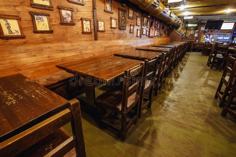 Interior pub status. Kiev, Ukraine- March 19, 2018. wooden interior of a classic expensive status beer pub. without people royalty free stock photography