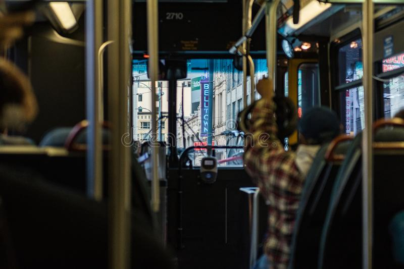 Interior of a public bus passing through the Belltown neighborhood in Seattle royalty free stock photo