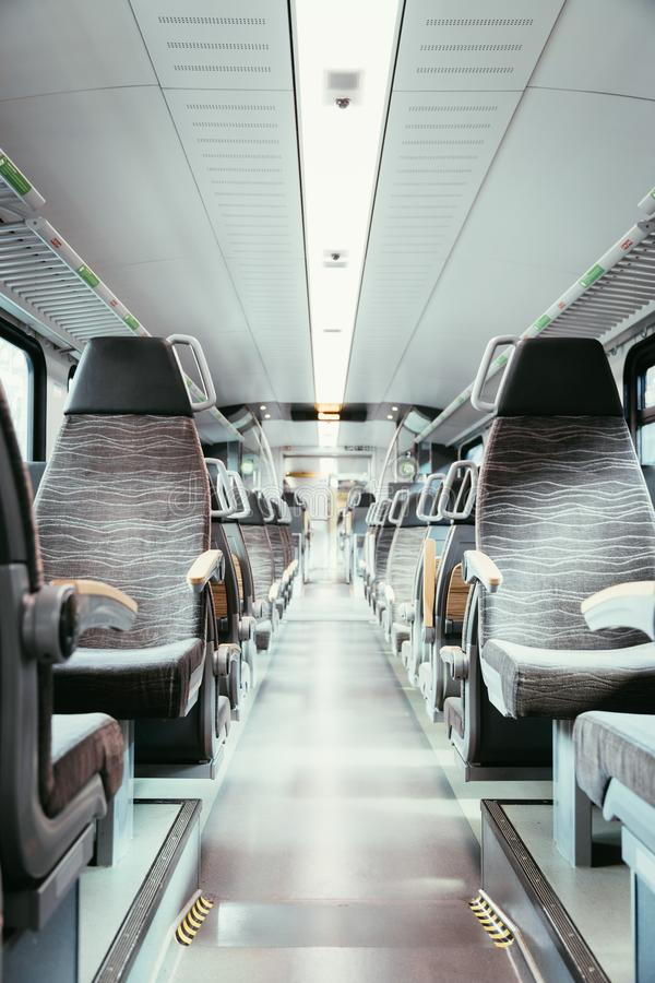 Interior of a public transport train, empty seats. Interior of a public transport train, blurry background bus commuting subway journey travel seats empty nobody royalty free stock image