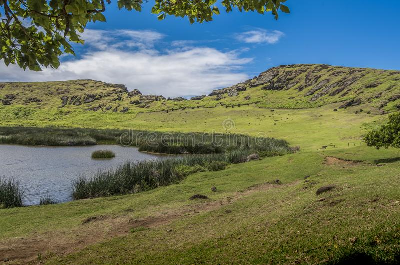 Interior of the Rano Raraku volcano with underground moai. Path on the hill of the moais of the Rano Raraku volcano where all the moai were sculpted royalty free stock image