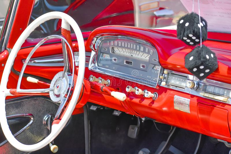 Interior of Red Car with Black Fuzzy Dice royalty free stock photo