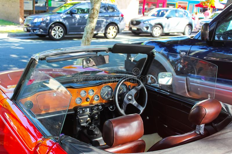 Interior of red convertible jaguar designed of left side driving parked on street on Bribie Island Queensland Australia circa 9-2 royalty free stock image
