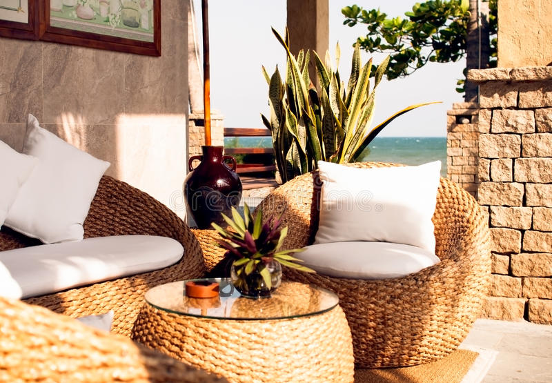 Interior of relax place with sea view outdoors. Interior of relax place from nature materials with sea view stock photo