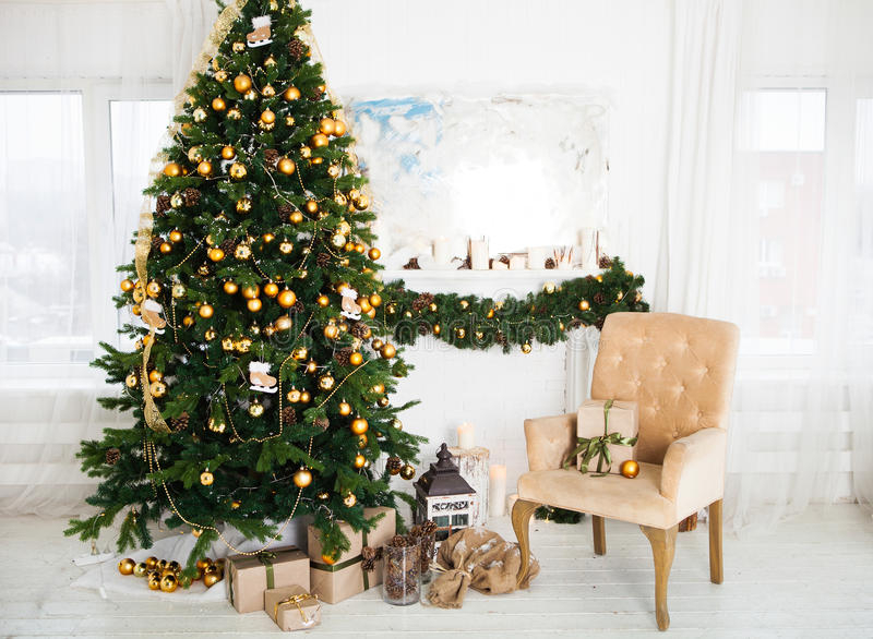 Interior room decorated in Christmas style. No people. An empty. Chair. Neutral colors. Home comfort of modern home stock images