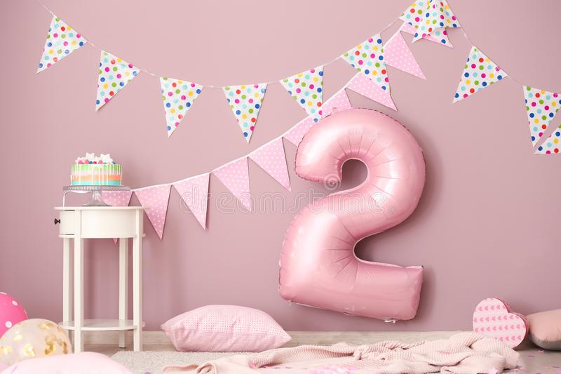 Interior of room decorated for second birthday party royalty free stock photography