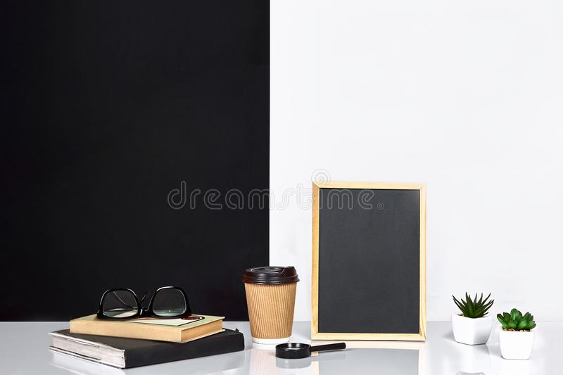 Interior room decoration american or scandinavian style with books, succulent in the pot. Poster with place for text. Interior room decoration american or stock photos