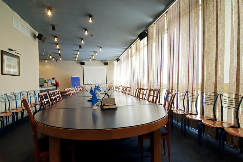 Interior of a room for meetings. Interior of a conference hall with the big table for meetings royalty free stock image