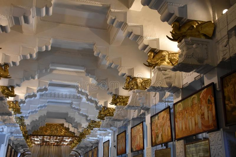 Interior of room at Temple of the Sacred Tooth Relic in Kandy. Room with golden elephant statues and pictures depicting story of the sacred tooth relic at the royalty free stock photos