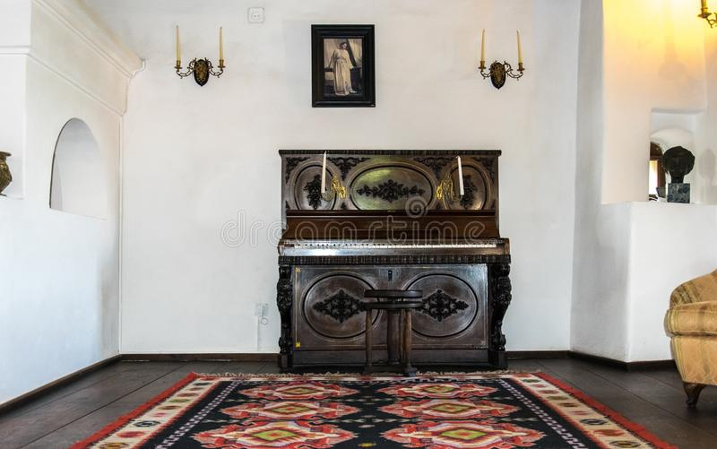 Interior rooms of the medieval Bran Castle in Romania. Antique furniture in the apartment of the legendary vampire Dracula stock image