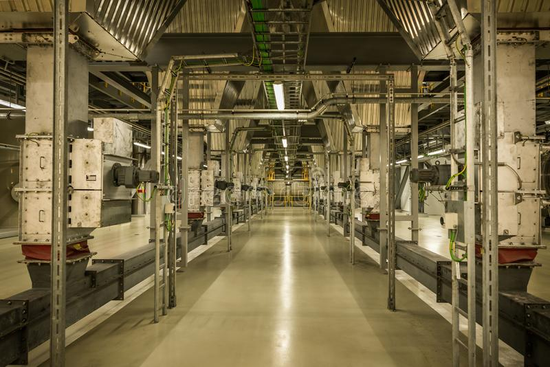 The interior of the Roskilde Power Plant with electrical installations and pipes stock photography