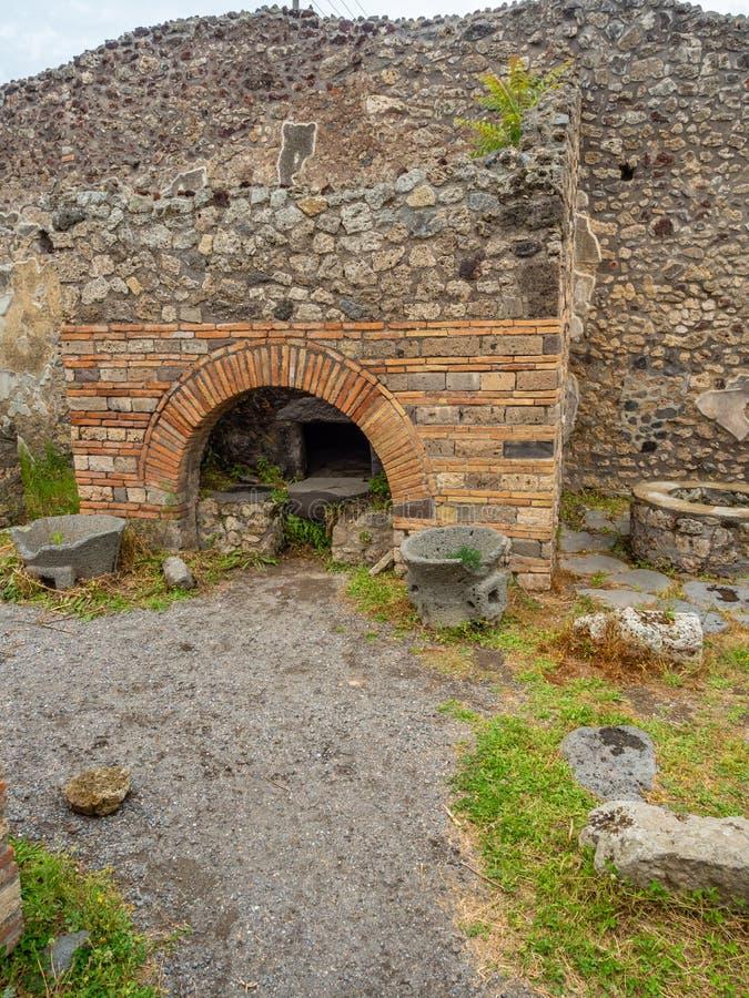 Roman villa in Pompeii, Italy. World Heritage List. Interior of ruined Roman villa in the ancient Roman city of Pompeii, near modern Naples in Italy. Cloudy stock image