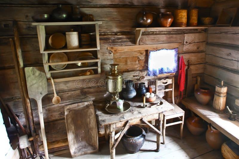 Interior of the Russian peasant hut. Kitchen interior, samovar, pots, kitchen utensils, oven stock images
