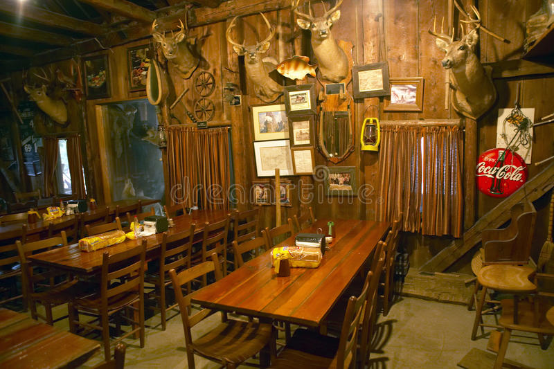 Interior of rustic old restaurant with hunting d�cor stock photography