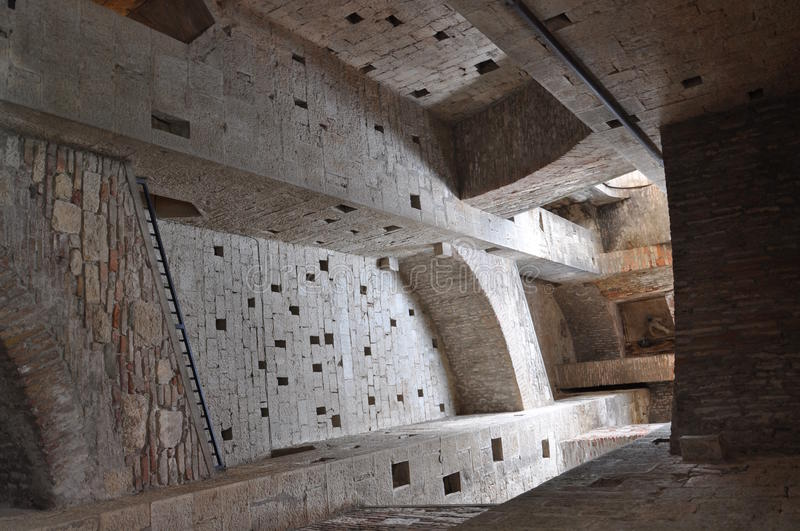 Interior of san fortunato tower, todi. Inner view of the medieval stone tower with multiple flight of stairs royalty free stock photo