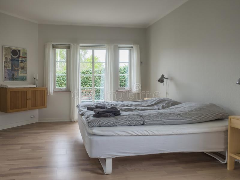 Interior from a Scandinavian home, sleeping room stock photography