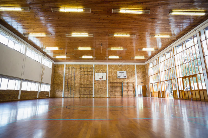 Interior of school gym hall. With basketball court royalty free stock image