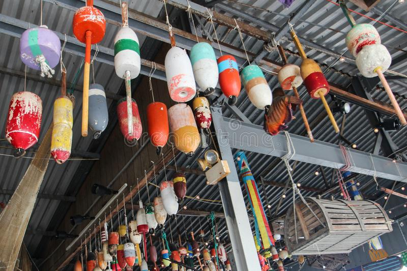 A Colorful Collection of Lobster and Crab Trap Buoys Used as Decoration. The interior of this seafood restaurant makes it a fun place to eat and look at the royalty free stock image