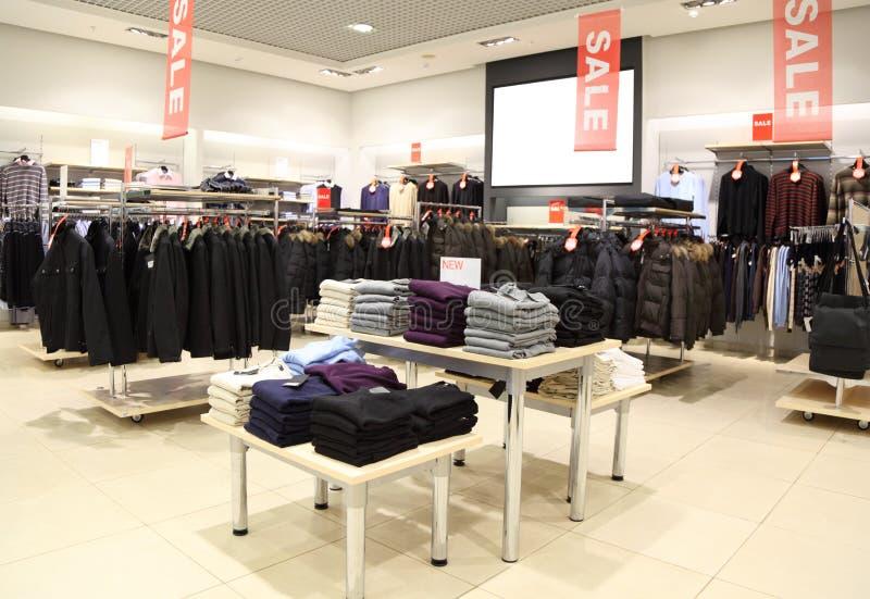 Interior of shop of clothes stock photos